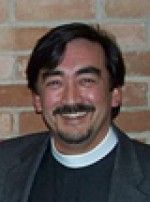 The Rev. Michael  Adams